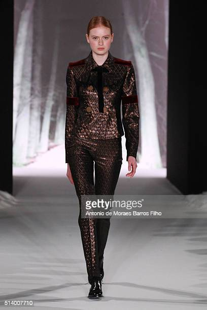 Model walks the runway during the Valentin Yudashkin show as part of the Paris Fashion Week Womenswear Fall/Winter 2016/2017 on March 6, 2016 in...