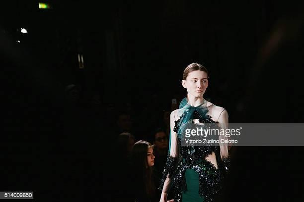Model walks the runway during the Valentin Yudashkin show as part of Paris Fashion Week Womenswear Fall/Winter 2016/2017 on March 6, 2016 in Paris,...