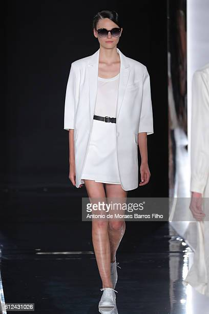 Model walks the runway during the Valentin Yudashkin show as part of the Paris Fashion Week Womenswear Spring/Summer 2017 on October 4, 2016 in...