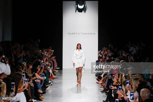 Model walks the runway during the Valentin Yudashkin show as part of Paris Fashion Week Womenswear Spring/Summer 2018 on October 2, 2017 in Paris,...