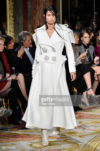A model walks the runway during the Valentin Yudashkin show as part of the Paris Fashion Week Womenswear Fall/Winter 2018/2019 on March 5 2018 in...