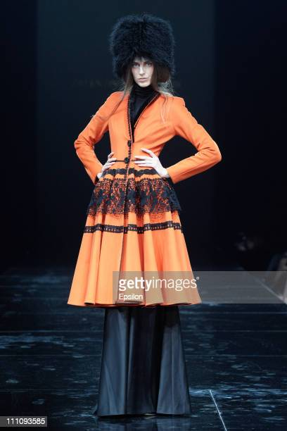 Model walks the runway during the Valentin Yudashkin show on March 29, 2011 during the Volvo Fashion Week Moscow - Day 1 in Moscow, Russia.