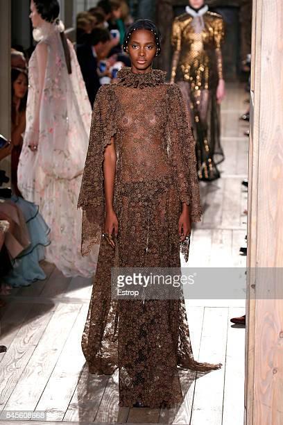 A model walks the runway during the Valentino designed by Pier Paolo Piccioli Maria Grazia Chiuri Haute Couture Fall/Winter 20162017 show as part of...