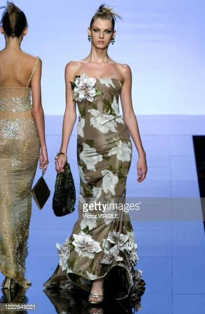 Model walks the runway during the Valentino Haute Couture Fall/Winter 2000-2001 fashion show as part of the Paris Haute Couture Fashion Week on July...