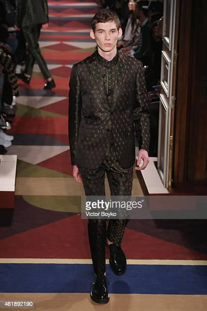 A model walks the runway during the Valentino Menswear Fall/Winter 20152016 show as part of Paris Fashion Week on January 21 2015 in Paris France