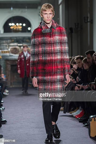 A model walks the runway during the Valentino Menswear Fall/Winter 20162017 show as part of Paris Fashion Week on January 20 2016 in Paris France