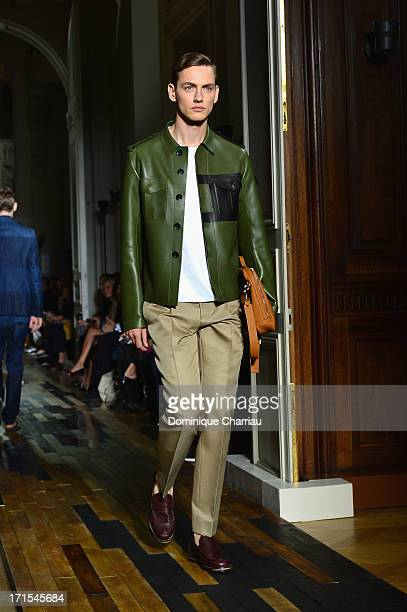 A model walks the runway during the Valentino Menswear Spring/Summer 2014 show as part of the Paris Fashion Week on June 26 2013 in Paris France