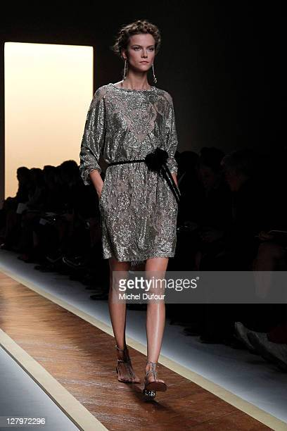 A model walks the runway during the Valentino Ready to Wear Spring / Summer 2012 show during Paris Fashion Week at Espace Ephemere Tuileries on...