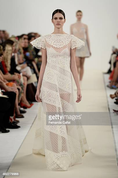 A model walks the runway during the Valentino Sala Bianca 945 Event at The Former Whitney Museum on December 10 2014 in New York City