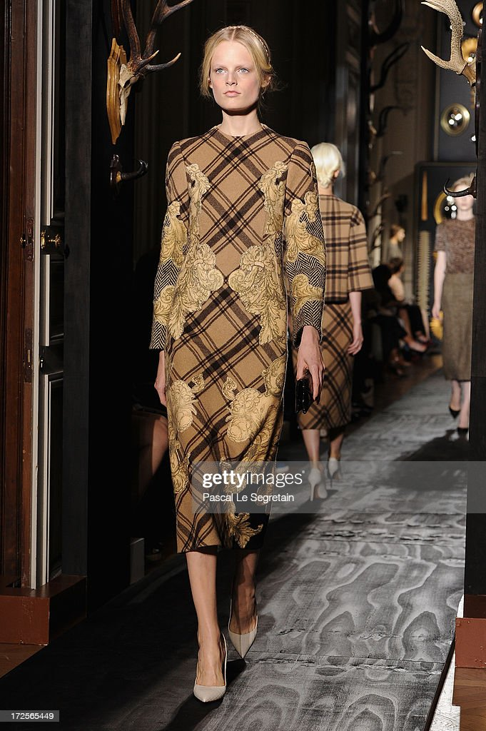 A model walks the runway during the Valentino show as part of Paris Fashion Week Haute-Couture Fall/Winter 2013-2014 at Hotel Salomon de Rothschild on July 3, 2013 in Paris, France.