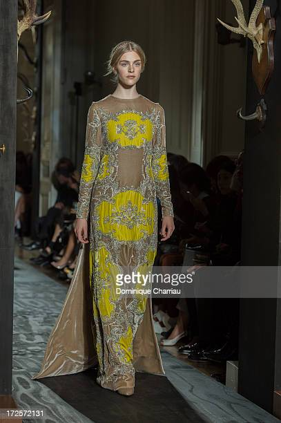 A model walks the runway during the Valentino show as part of Paris Fashion Week HauteCouture Fall/Winter 20132014 at Hotel Salomon de Rothschild on...