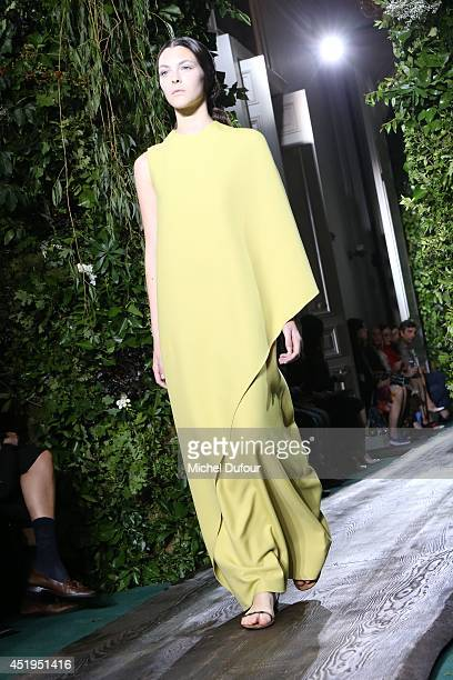 A model walks the runway during the Valentino show as part of Paris Fashion Week Haute Couture Fall/Winter 20142015 at Hotel Salomon de Rothschild on...