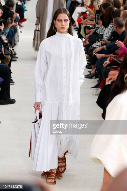 A model walks the runway during the Valentino show as part of the Paris Fashion Week Womenswear Spring/Summer 2019 on September 30 2018 in Paris...