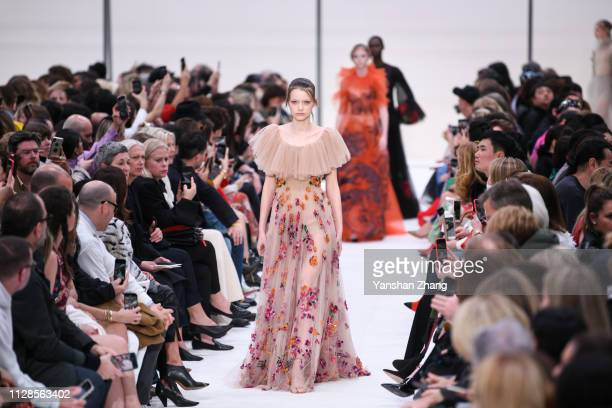 A model walks the runway during the Valentino show as part of the Paris Fashion Week Womenswear Fall/Winter 2019/2020 on March 3 2019 in Paris France