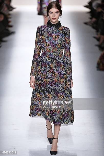 A model walks the runway during the Valentino show as part of the Paris Fashion Week Womenswear Fall/Winter 20142015 on March 4 2014 in Paris France