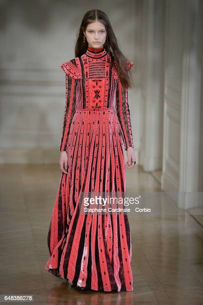 A model walks the runway during the Valentino show as part of the Paris Fashion Week Womenswear Fall/Winter 2017/2018 on March 5 2017 in Paris France