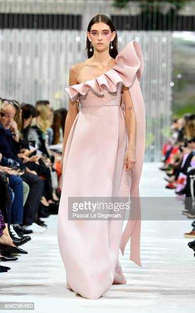A model walks the runway during the Valentino show as part of the Paris Fashion Week Womenswear Spring/Summer 2018 on October 1 2017 in Paris France