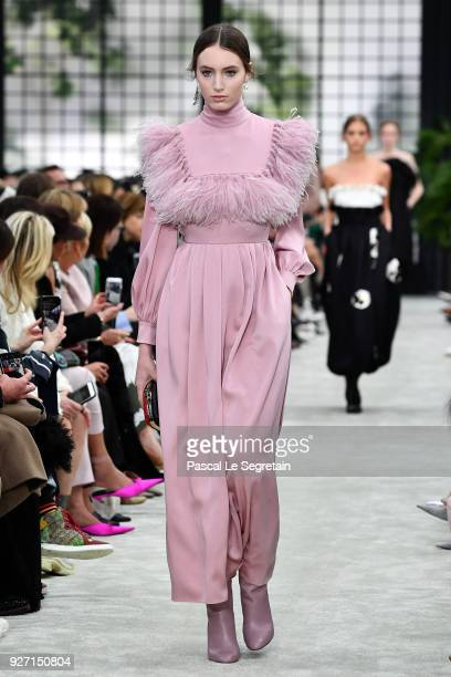 A model walks the runway during the Valentino show as part of the Paris Fashion Week Womenswear Fall/Winter 2018/2019 on March 4 2018 in Paris France