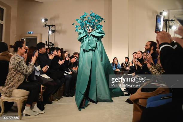A model walks the runway during the Valentino Spring Summer 2018 show as part of Paris Fashion Week on January 24 2018 in Paris France