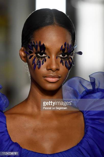 A model walks the runway during the Valentino Spring Summer 2019 show as part of Paris Fashion Week on January 23 2019 in Paris France