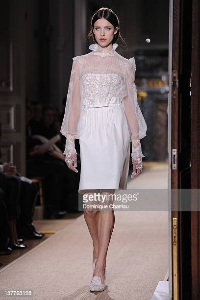A model walks the runway during the Valentino Spring/Summer 2012 HauteCouture Show as part of Paris Fashion Week at Hotel Salomon de Rothschild on...