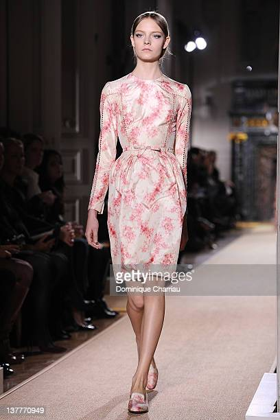Model walks the runway during the Valentino Spring/Summer 2012 Haute-Couture Show as part of Paris Fashion Week at Hotel Salomon de Rothschild on...