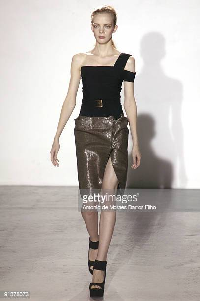 A model walks the runway during the Veronique Leroy Pret a Porter show as part of the Paris Womenswear Fashion Week Spring/Summer 2010 at Espace...
