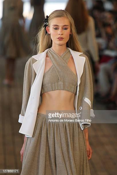 A model walks the runway during the Veronique Leroy Ready to Wear Spring / Summer 2012 show during Paris Fashion Week at Cite de la Mode Et du Design...
