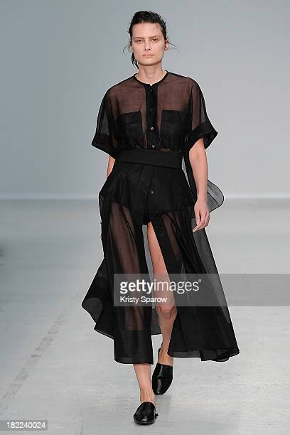 Model walks the runway during the Veronique Leroy show as part of Paris Fashion Week Womenswear Spring/Summer 2014 on September 28, 2013 in Paris,...