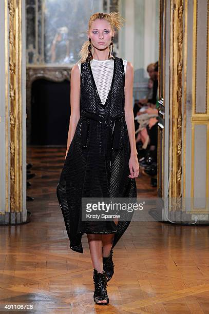 A model walks the runway during the Veronique Leroy show as part of Paris Fashion Week Womenswear Spring/Summer 2016 on October 3 2015 in Paris France