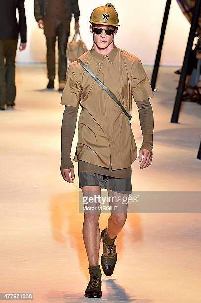 A model walks the runway during the Versace Ready to Wear fashion show as part of Milan Men's Fashion Week Spring/Summer 2016 on June 20 2015 in...