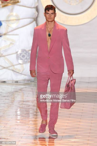 A model walks the runway during the Versace show as a part of Milan Fashion Week Menswear Spring/Summer 2015 on June 21 2014 in Milan Italy