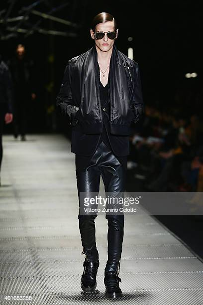 A model walks the runway during the Versace Show as a part of Milan Menswear Fashion Week Fall Winter 2015/2016 on January 17 2015 in Milan Italy