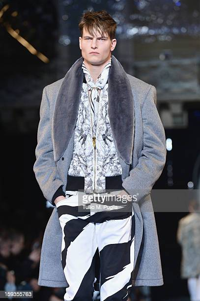 Model walks the runway during the Versace show as part of Milan Fashion Week Menswear Autumn/Winter 2013 on January 12, 2013 in Milan, Italy.