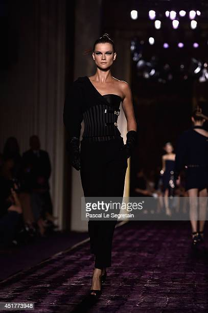 A model walks the runway during the Versace show as part of Paris Fashion Week Haute Couture Fall/Winter 20142015 on July 6 2014 in Paris France