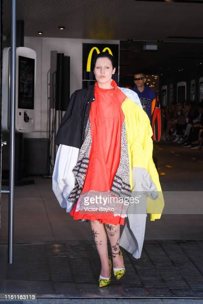 Model walks the runway during the Vetements Menswear Spring Summer 2020 show at McDonalds on Champs-Elysees as part of Paris Fashion Week on June 20,...