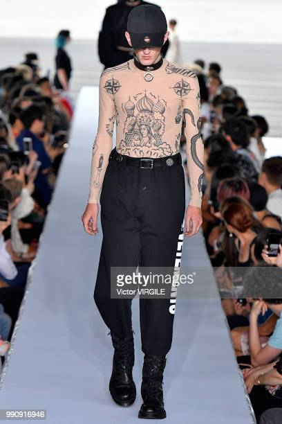A model walks the runway during the Vetements Ready to Wear Spring/Summer 2019 fashion show as part of Paris Fashion Week on July 1 2018 in Paris...