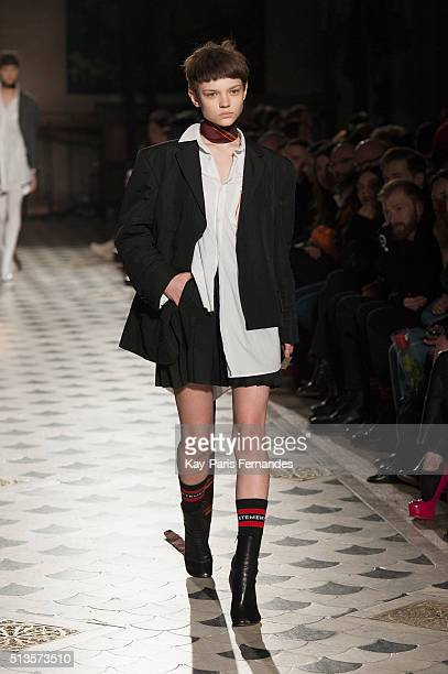 A model walks the runway during the Vetements show as part of the Paris Fashion Week Womenswear Fall/Winter 2016/2017 on March 3 2016 in Paris France