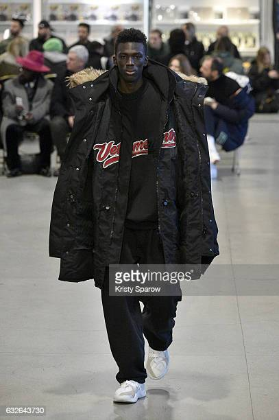 A model walks the runway during the Vetements Spring Summer 2017 show as part of Paris Fashion Week on January 24 2017 in Paris France