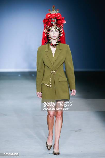 A model walks the runway during the Victor Hugo Mattos as part of the Estufa project fashion show during Sao Paulo Fashion Week N46 Winter 2019 at...