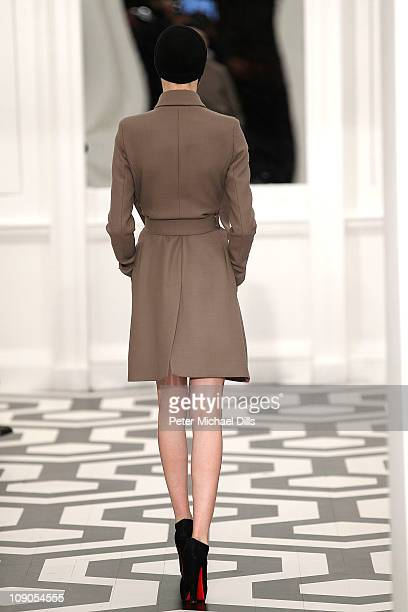 A model walks the runway during the Victoria Beckham Dresses Fall 2011 presentation during MercedesBenz Fashion Week at Private Studio on February 13...