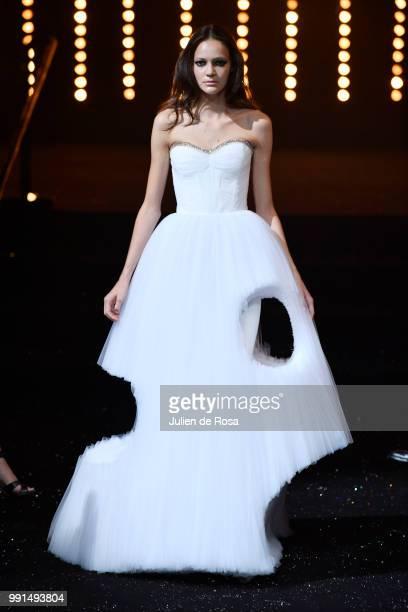 A model walks the runway during the Viktor Rolf Haute Couture Fall Winter 2018/2019 show as part of Paris Fashion Week on July 4 2018 in Paris France