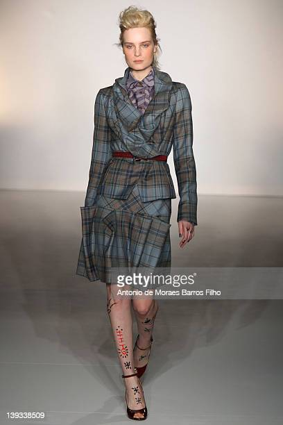 A model walks the runway during the Vivienne Westwood Autumn/Winter 2012 show at London Fashion Week at Goldsmiths' Hall on February 19 2012 in...