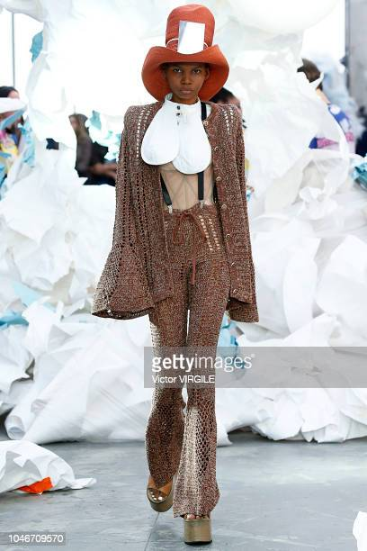 A model walks the runway during the Vivienne Westwood Ready to Wear fashion show as part of the Paris Fashion Week Womenswear Spring/Summer 2019 on...