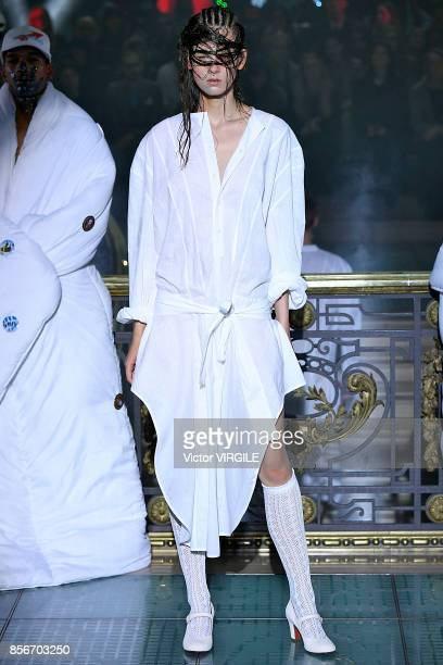 A model walks the runway during the Vivienne Westwood Ready to Wear Spring/Summer 2018 fashion show as part of Paris Fashion Week at on September 30...