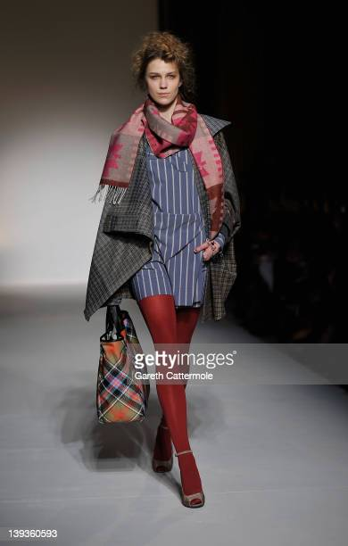 A model walks the runway during the Vivienne Westwood Red Label show as part of London Fashion Week Autumn/Winter 2012 at My Beautiful Fashion on...