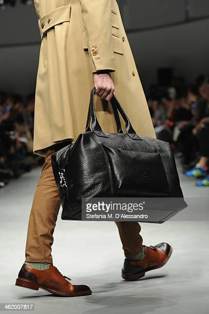 A model walks the runway during the Vivienne Westwood show as a part of Milan Fashion Week Menswear Autumn/Winter 2014 on January 12 2014 in Milan...
