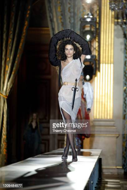 Model walks the runway during the Vivienne Westwood show as part of the Paris Fashion Week Womenswear Fall/Winter 2020/2021 on February 29, 2020 in...