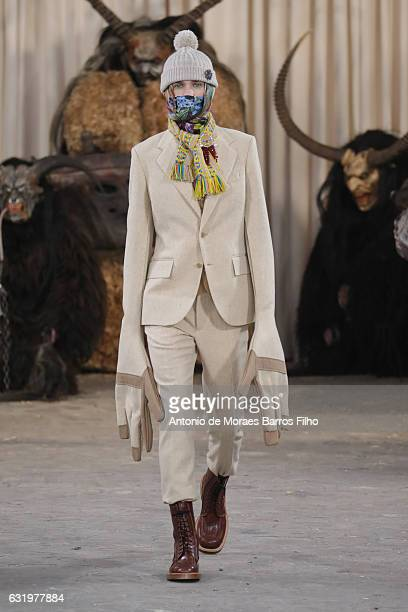 Model walks the runway during the Walter Van Beirendonck Menswear Fall/Winter 2017-2018 show as part of Paris Fashion Week on January 18, 2017 in...