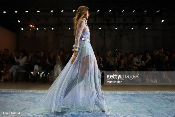 Model walks the runway during the We Are Kindred show at Mercedes-Benz Fashion Week Resort 20 Collections at Carriageworks on May 14, 2019 in Sydney,...